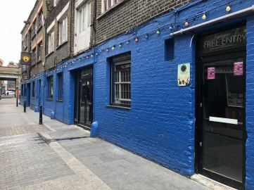 Street Art in Shoreditch: A blue wall outside the Shoreditch book store