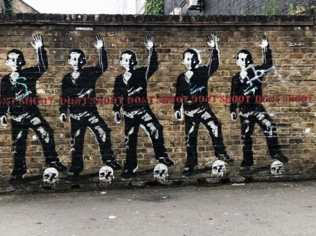 Street Art in Shoreditch: Political Art found on the wall at the front end of the Barrio subway