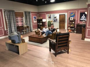 Comedy Central UK's Friends Fest 2018: Pixie Tenenbaum and her brother sat on the sofa on the set of Ross Geller's apartment from the hit TV show Friends