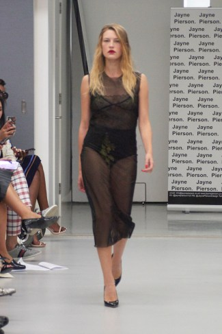 A model on the runway for Jayne Pierson SS19 at London Fashion Week Conde Naste College of Fashion and Design wearing a black voile shift dress (Fashion voyeur blog)