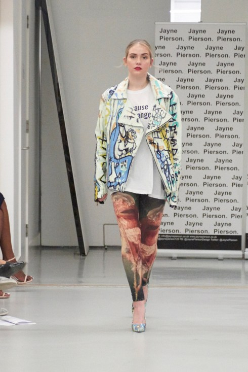 A model on the runway for Jayne Pierson SS19 at London Fashion Week Conde Naste College of Fashion and Design wearing painted leggings, a because de Change tee and a painted leather jacket (Fashion voyeur blog)