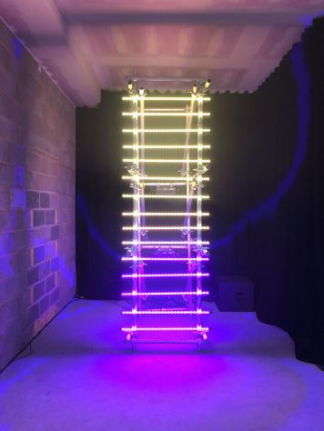 An image taken from the 2018 installation #MulberryLights at 100 Regent Street from fashion brand Mulberry as part of their Christmas campaign featuring a multi-coloured ladder light. Fashion Voyeur Blog