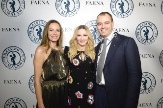 MIAMI BEACH, FL - DECEMBER 03: Carolina Parsons, Madonna, Milutin Gatsby attend Madonna presents An Evening of Music, Art, Mischief and Performance to Benefit Raising Malawi at Faena Forum on December 3, 2016 in Miami Beach, Florida. (Photo by Kevin Mazur/Getty Images for Bulgari)