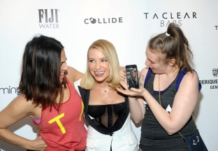 Jenni Konner, Tracy Anderson and Lena Dunham, left to right, FaceTime with Gwyneth Paltrow at the opening of the Tracy Anderson 59th Street studio, Wednesday, March 15, 2017 in New York. (Photo by Diane Bondareff/Invision for Tracy Anderson/AP Images)