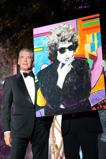 Pierce Brosnan and his painting, which sold for $  1.4 million. (Getty Images)