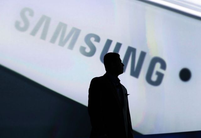 LAS VEGAS, NV - JANUARY 06: Samsung Electronics Vice President Nandra Ramachandran is silhouetted against a video presentation as he speaks during a press event at the Mandalay Bay Convention Center for the 2014 International CES on January 6, 2014 in Las Vegas, Nevada. CES, the world's largest annual consumer technology trade show, runs from January 7-10 and is expected to feature 3,200 exhibitors showing off their latest products and services to about 150,000 attendees. (Photo by Justin Sullivan/Getty Images)