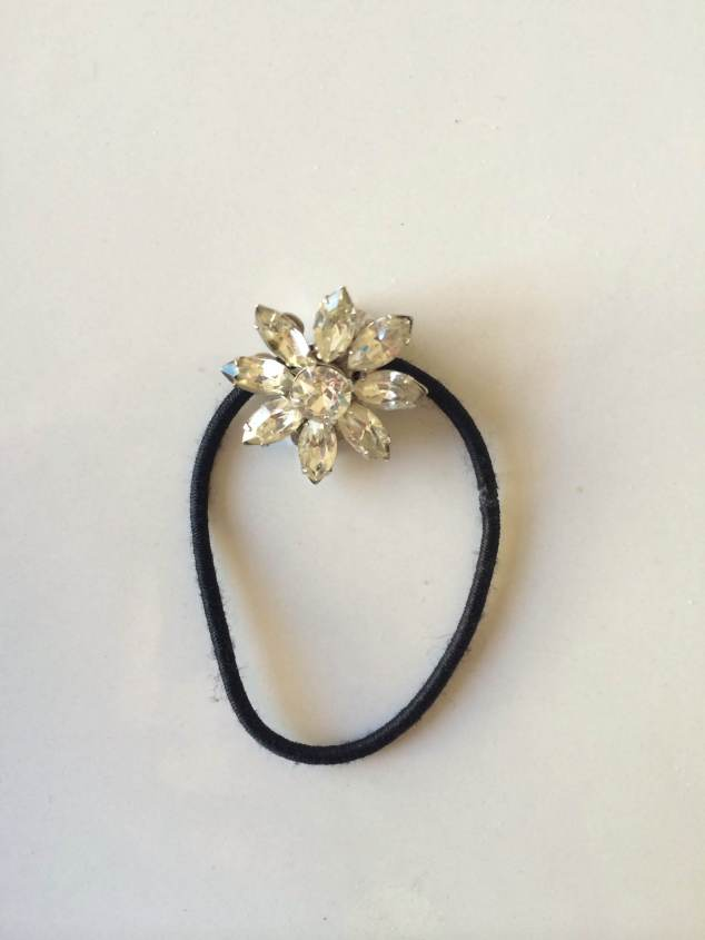 After: Hair Tie and Grandma's clip on earring connected for a little glitz for you ponytail!