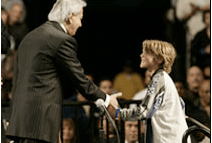 Samuel shaking hands with Benny Hinn in Long Beach