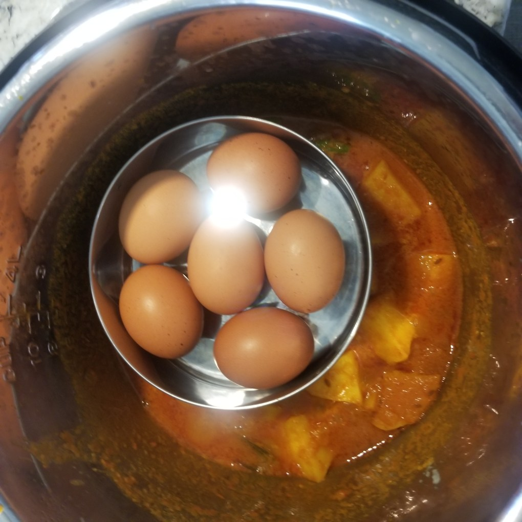 place eggs in a bowl on the trivet