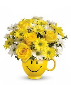 Yellow Roses and Daisies In A Happy Face Mug
