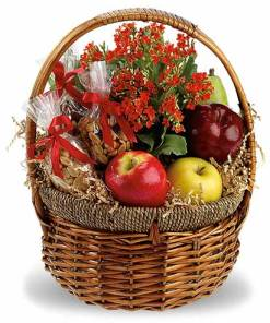 Fruit and Nuts In A Gift Basket With Flowers