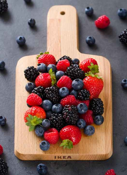 fresh berries on wooden cutting board