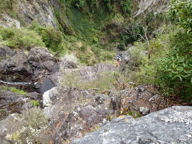 Helen going down the main drop of Carrabeanga Falls.