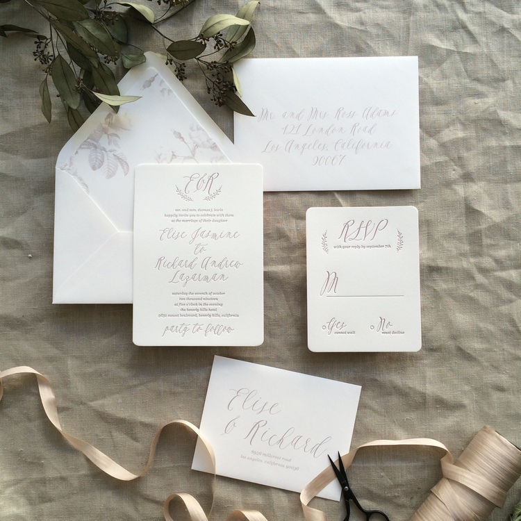 Elise by BTElements, Whimsical rustic invitation with monogram laurel, Calligraphy handwritten style script, Mauve letterpress ink on white cotton paper, Muted floral envelope liner
