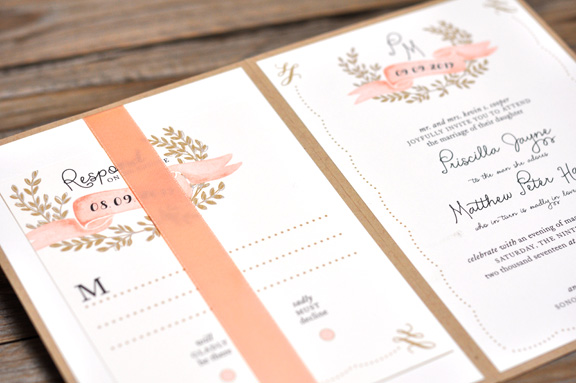 Priscilla by BTElements, Rustic Ribbon Pocket Invitation with Monogram Laurel, Whimsical Fonts, Sand peach and black color palette with ivory and kraft papers, Flat printed