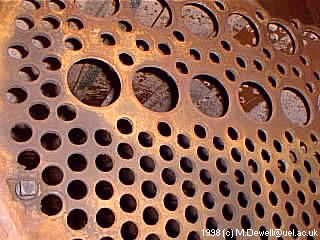 Boiler tube plate where I would cut out and weld back the tubes