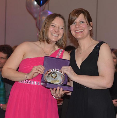 Kirsty presenting Tamsyn with the Lordshill Road Runners Club Participation Award 2013