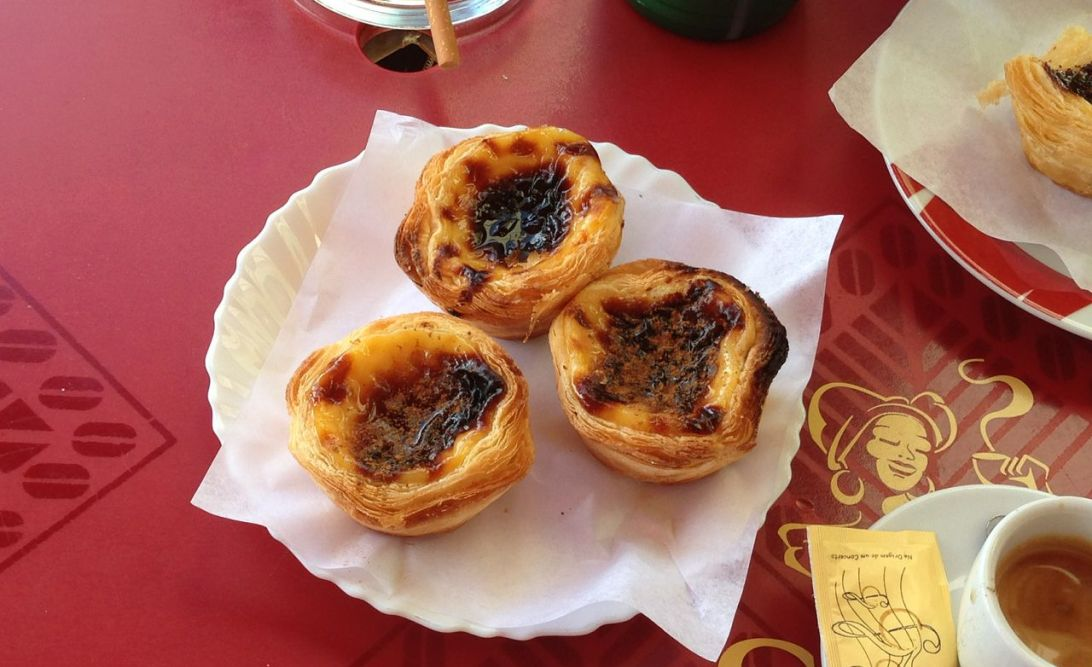 Three pastel de nata (egg custard tarts)