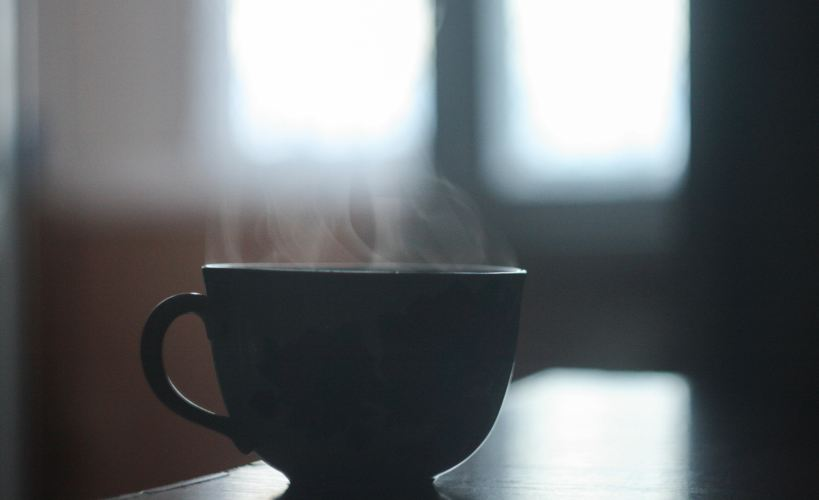 Silhouette of a steaming hot drink