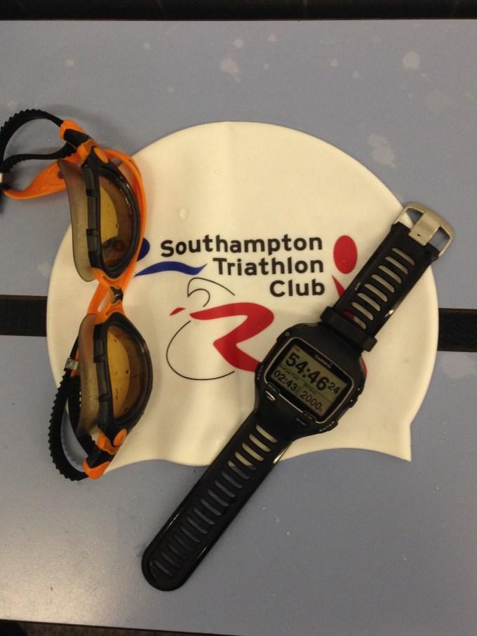 Tri club swim hat with goggles and Garmin