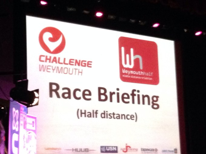 Large screen saying Race Briefing.