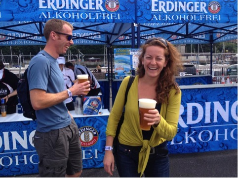 James and Roelie holding pints of Erdinger.