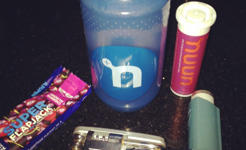 Superfood cherry and almond flapjack, nuun bottle, nuun triple berry tabs, inhaler and bike multitool.