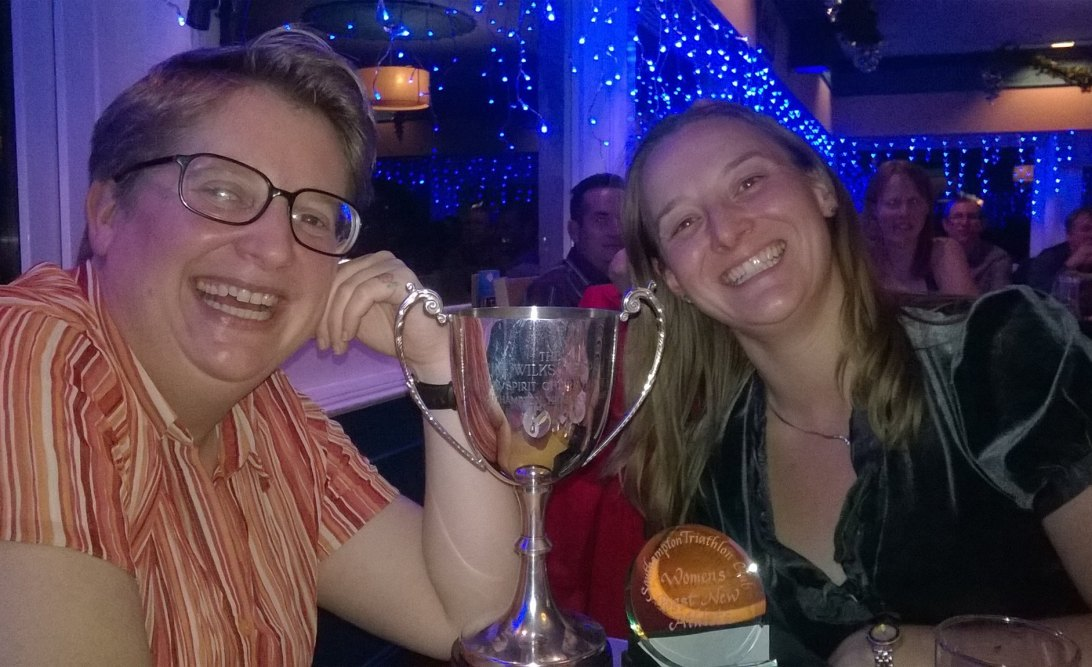 Tamsyn and Liz posing with their Tri Club trophies