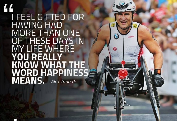 """Alex Zanardi at Ironman Kona 2014. A quote is written on top of the picture is the text """"I feel gifted for having had more than one of these days in my life where you really know what the word happiness means""""."""
