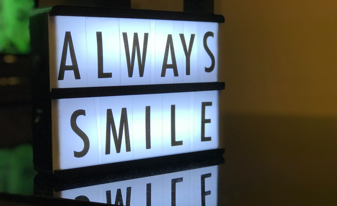 Sign saying 'Always smile'