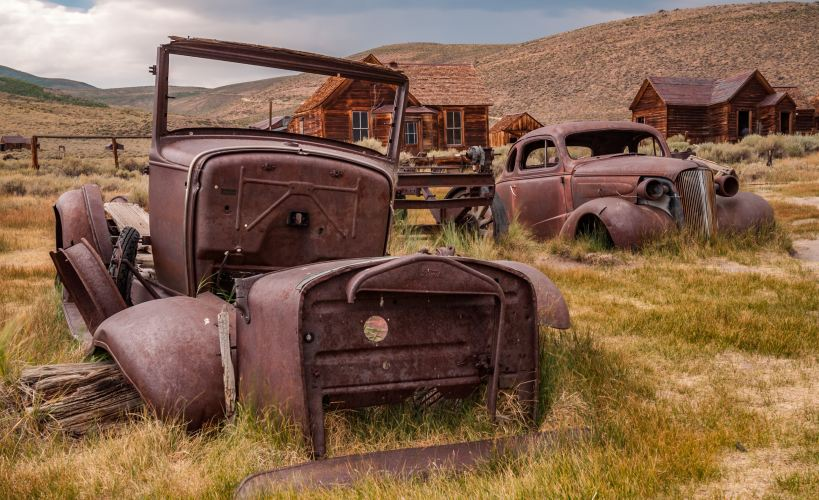 Abandoned and rusted cars