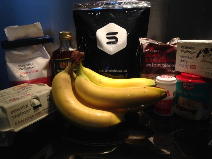 The ingredients before I started baking: eggs, flour, syrup, bananas, protein powder, walnuts, butter baking powder and salt.