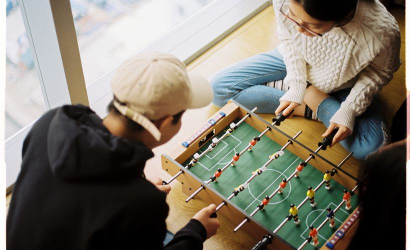 Friendly competition - a couple playing foosball
