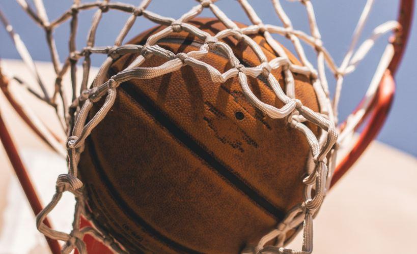 Basketball in a hoop.