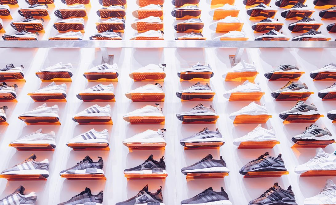 A wall of trainers in a shoe shop