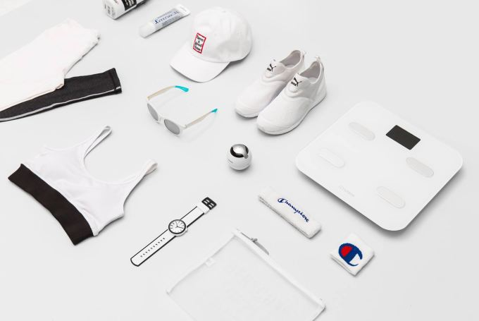 Flat lay of white sportswear with some bathroom scales