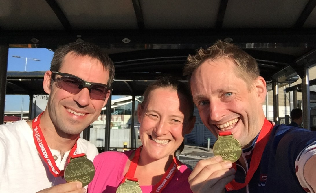 Stuart, Tamsyn and Jez with medals from London Triathlon