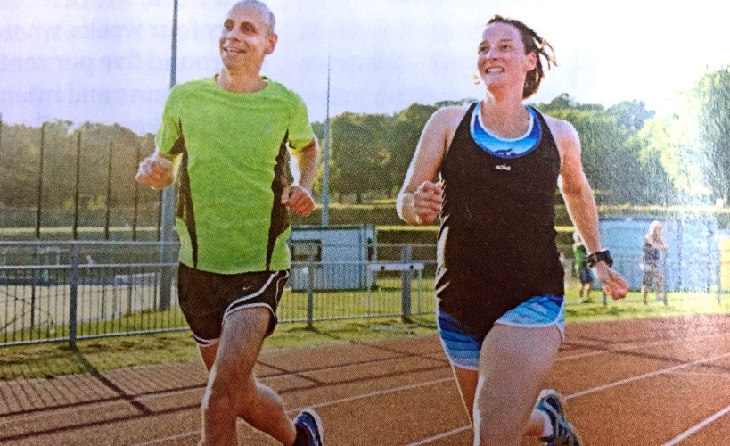Jez and Tamsyn running on a track together