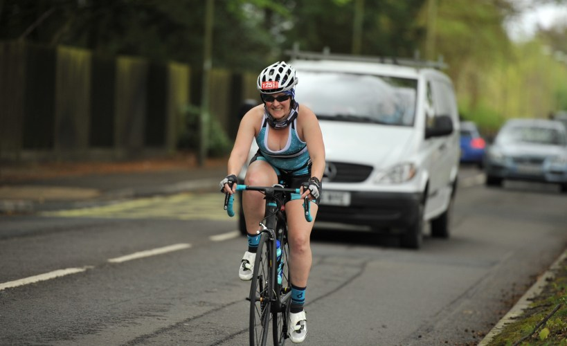 Tamsyn cycling during Winchester May Day Tri