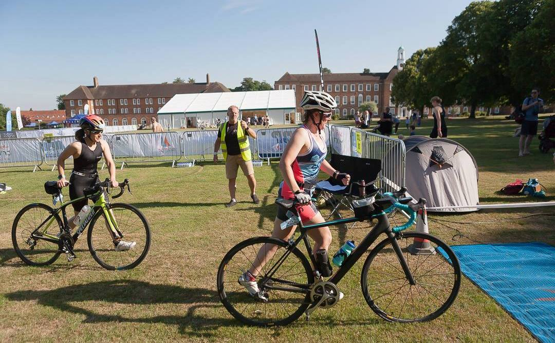 Tamsyn running with her bike at St Swithuns Tri