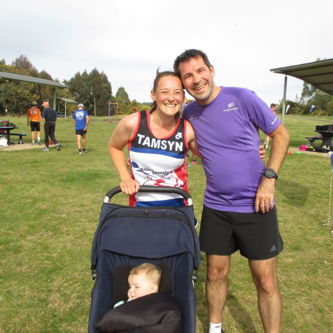 Stuart and Tamsyn with M asleep in her buggy at Orange parkrun.