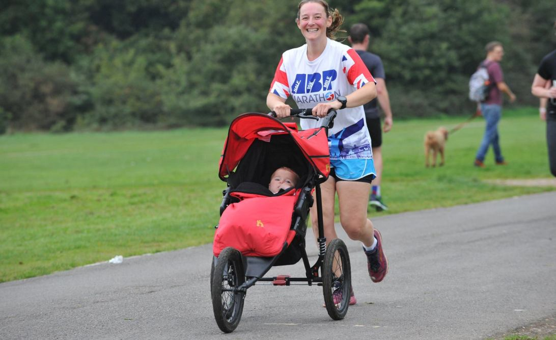 Tamsyn running with M in her buggy at Southampton parkrun on 14th October 2017.