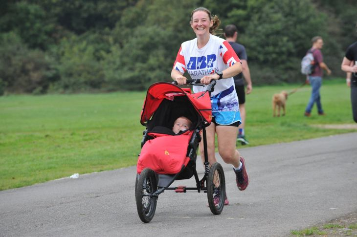 Tamsyn running with her buggy at Southampton parkrun on  14th Oct 2017.