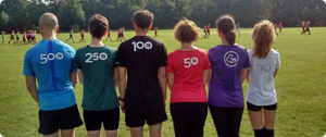6 people wearing different parkrun club t-shirts