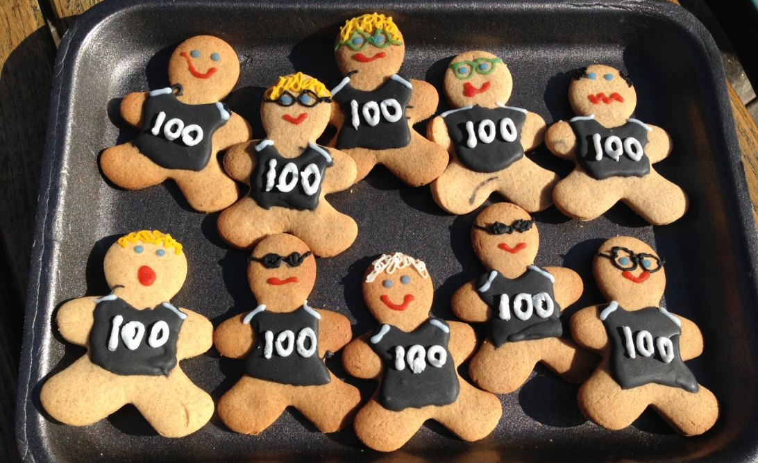 Gingerbread men with black 100 t-shirts iced on.