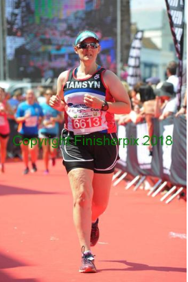 Tamsyn finishing Long Course Weekend run