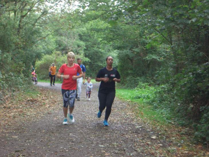 Tamsyn and Ellie with M in the background during parkrun