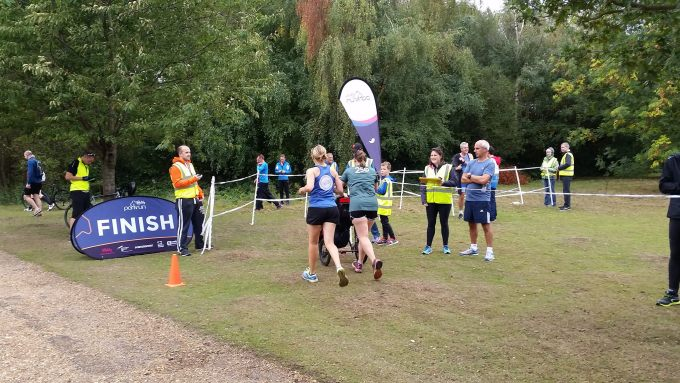 Rear view of Tamsyn and Ellie heading to the finish at Dinton Pastures parkrun