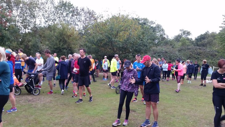 Tamsyn in the background of a picture before the start of Dinton Pastures parkrun