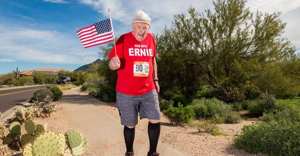 Ernie Endrus running whilst holding a flag.